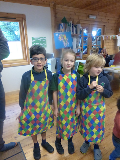 Children serving cakes at the coffee morning