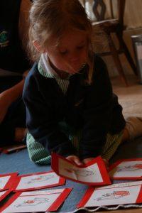 A pre school child works with the montessorui materials in the pre school